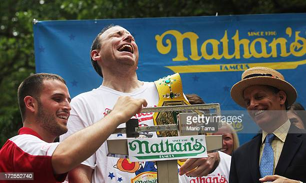 Men's world record holder Joey Chestnut laughs as he is weighed at the Nathan's Famous Fourth of July International Hot Dog Eating Contest weighin...