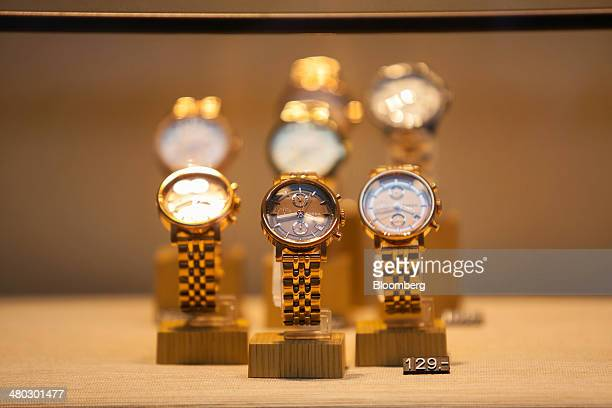 Men's wristwatches sit in the window display of a Fossil store operated by Fossil Group Inc in Dusseldorf Germany on Saturday March 22 2014 Germany...