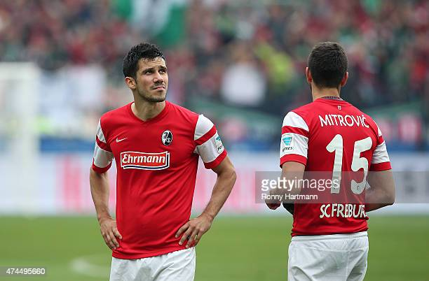 Mensur Mujdza and Stefan Mitrovic of Freiburg look dejected after the Bundesliga match between Hannover 96 and SC Freiburg at HDIArena on May 23 2015...