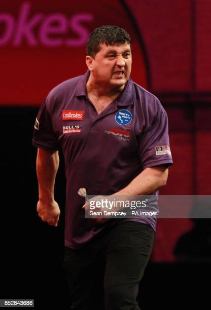 Mensur Suljovic celebrates a set against Mark Webster during day seven of The Ladbrokes World Darts Championship at Alexandra Palace London