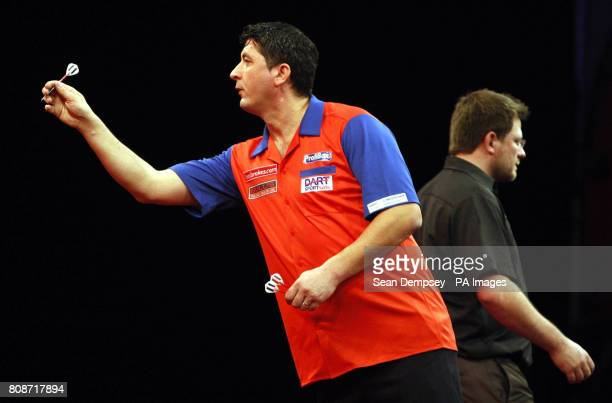 Mensur Suljovic in action during the Ladbrokescom World Darts Championship at Alexandra Palace London