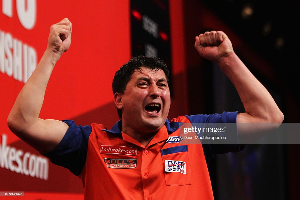 Mensur Suljovic of Austria celebrates his win against James Wade of England during day 10 in the 2011 Ladbrokescom World Darts Championship at...