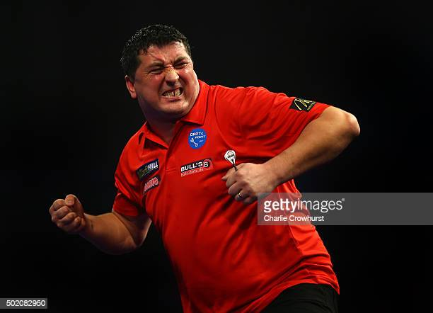 Mensur Suljovic of Austria celebrates winning his first round match against Jermaine Wattimena of Holland during the 2016 William Hill PDC World...