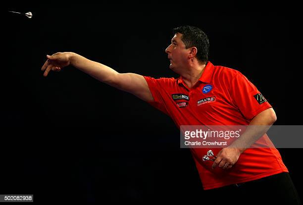 Mensur Suljovic of Austria in action during his first round match against Jermaine Wattimena of Holland during the 2016 William Hill PDC World Darts...
