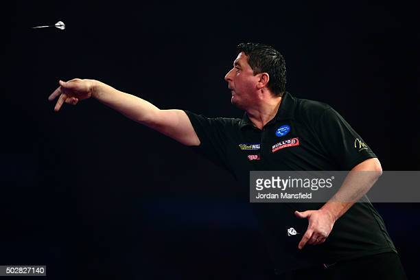 Mensur Suljovic of Austria in action during his third round match against Adrian Lewis of England on Day Eleven of the 2016 William Hill PDC World...