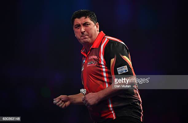 Mensur Suljovic of Serbia reacts during his first round match against Ron Meulenkamp of the Netherlands on day seven of the 2017 William Hill PDC...