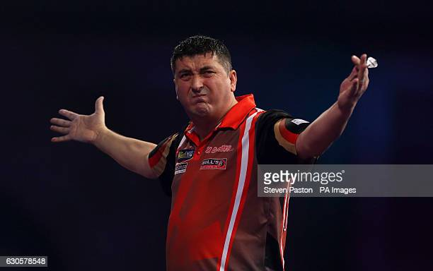 Mensur Suljovic reacting during day ten of the William Hill World Darts Championship at Alexandra Palace London