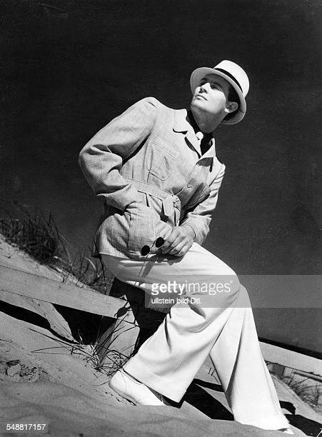 an with white gabardine pants and naturalcolored linen jacket to it a dark blue polo shirt model Benedict 1938 Photographer Sonja Georgi Published by...