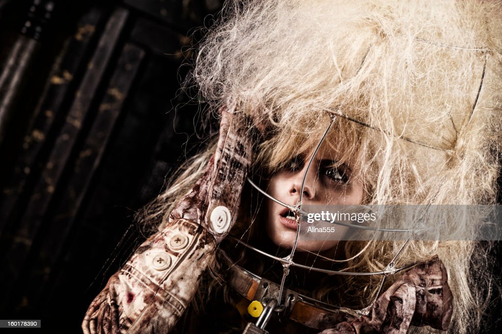 Mental ilness: crazy woman in straight jacket : Stock Photo