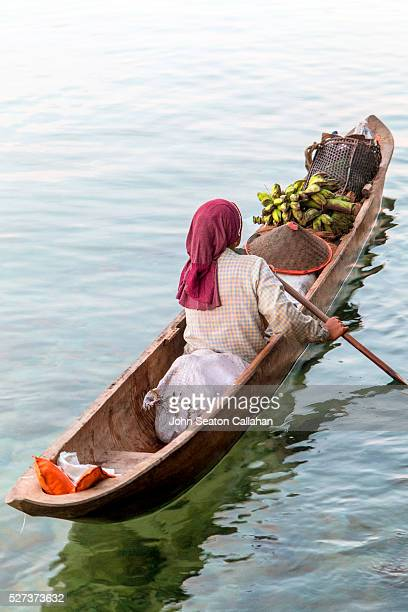 Mentawai woman in canoe