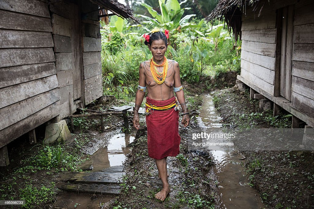 A Mentawanese woman Bai LauLau walks to collect flowers on May 26 2014 in Butui Village Siberut Island West Sumatra Indonesia Sikerei is the leader...