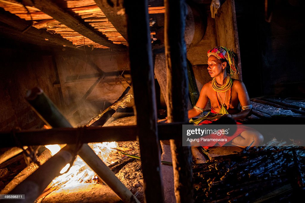 A Mentawanese woman Bai Lepon cooks sagoo during Inauguration Ritual preparation for Aman Gotdai as a New Sikerei on May 24 2014 in Butui Village...