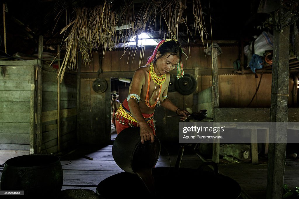 A Mentawanese woman Bai Lepon pours water to cook during Inauguration Ritual preparation for Aman Gotdai as a New Sikerei on May 25 2014 in Butui...