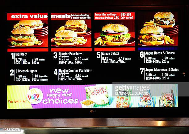 A menu displays US fast food chain McDonald's beef burger menu in New York January 28 2011 Beef prices have been increasing 61 percent for the...