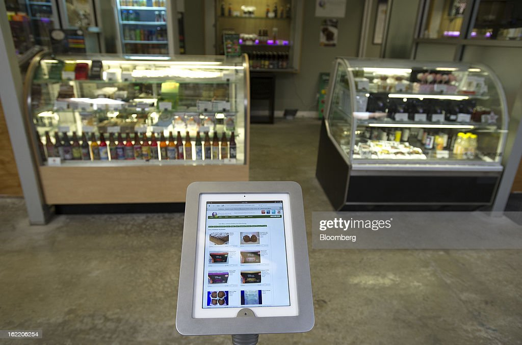 Menu items available to be ordered are displayed on an Apple Inc. iPad at the Palliative Health Center, a medical-marijuana dispensary, in San Jose, California, U.S., on Thursday, Feb. 7, 2013. The dispensary, which provides monthly classes on cooking with marijuana-infused products, draws tech workers from employers including Adobe Systems Inc., EBay Inc., Cisco Systems Inc., Hewlett-Packard Co. and Applied Materials Inc., according to Ernie Arreola, the assistant manager. Photographer: David Paul Morris/Bloomberg via Getty Images