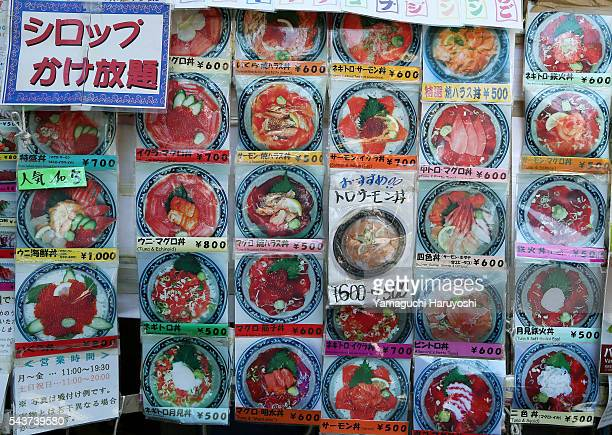 A menu of Japanese restaurant is displayed at at Ameyoko market in Tokyo Japan Sep 2013 Ameyoko is a bustling outdoor marketplace and Tokyo's most...
