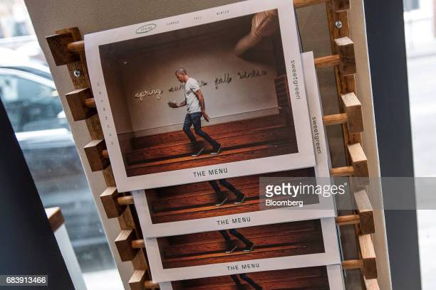 Menus hang on display inside a Sweetgreen Inc restaurant in San Francisco California US on Tuesday May 16 2017 Sweetgreen a hip lunch joint has opted...
