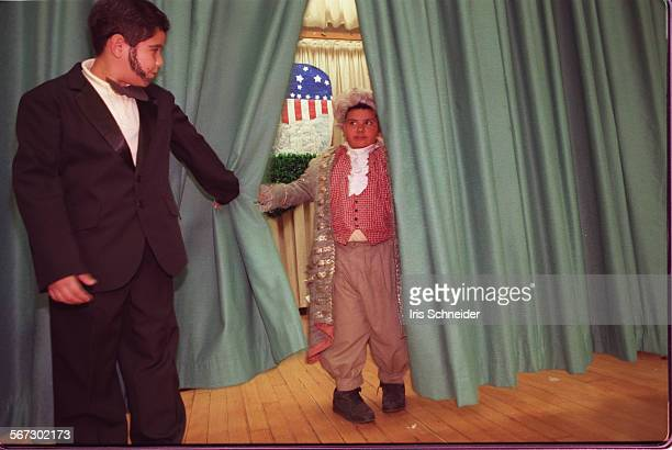 MEPresidents10214ISJesus Aguilar as Abe Lincoln and Henry Vides as Thomas Jefferson take a curtain call at Betty Plasencia Elementary School...