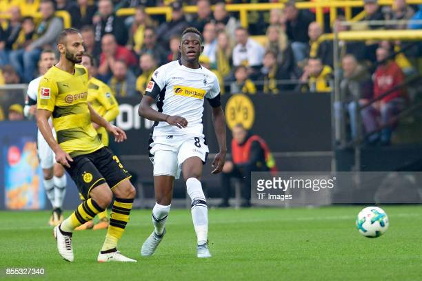 Ömer Toprak of Dortmund and Denis Zakaria of Moenchengladbach battle for the ball during the Bundesliga match between Borussia Dortmund and Borussia...