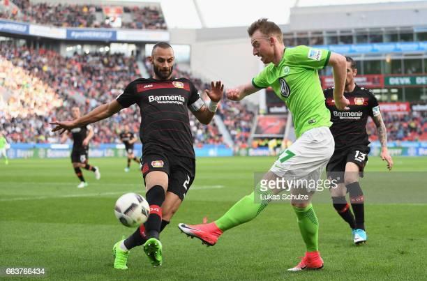 Ömer Toprak of Leverkusen challenges Maximilian Arnold of Wolfsburg during the Bundesliga match between Bayer 04 Leverkusen and VfL Wolfsburg at...