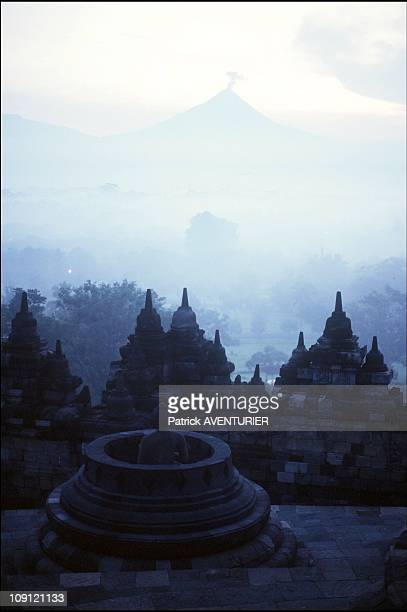 Merapi Volcano With Borobudur Buddhist Temple In The Foreground On January 7Th Indonesia