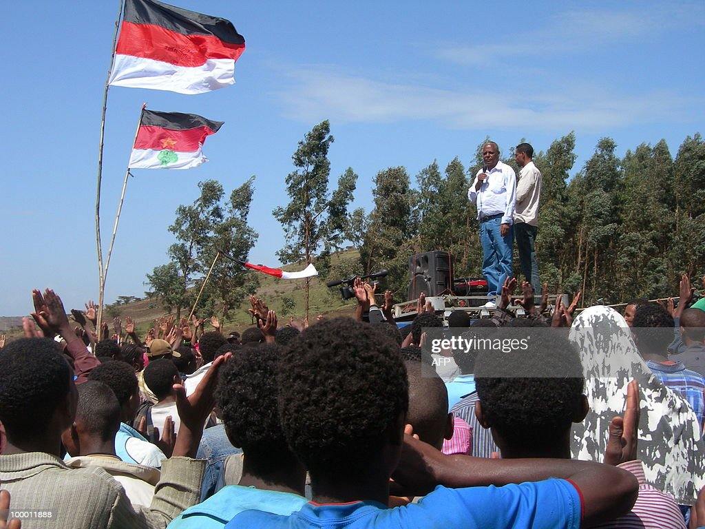 Merara Gudina (top L), the chairman of the Oromo people's Congress (OPC) addresses a crowd of supporters during a political rally in in his home town of Tokkee on May 15, 2010. A mounting rise in electoral related violence has been concentrated in the Oromo region, which includes the largest number of constituencies in Ethiopia, making it strategically important to the political adversaries. The Oromos make up a quarter of the population of 80 million people and thus constitute Ethiopia's largest ethnic group, out of dozens.