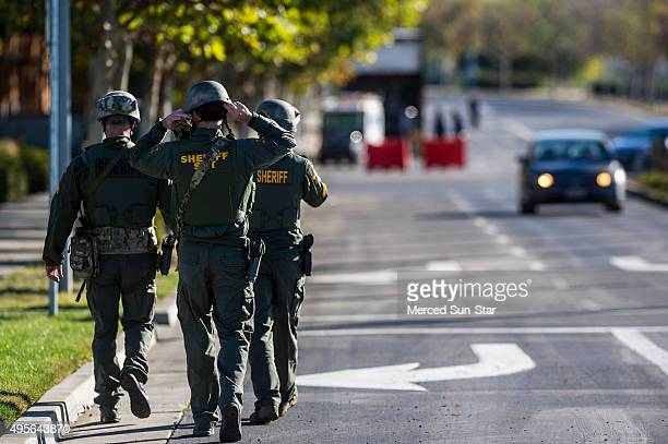 Merced County Sheriff SWAT members enter the University of California Merced campus after a reported stabbing on Wednesday Nov 4 in Merced Calif...
