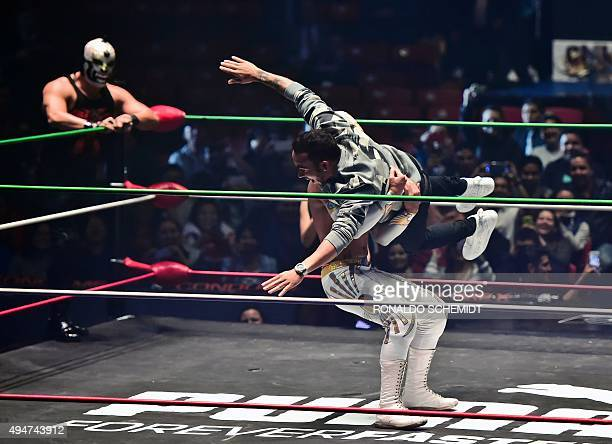 Mercedes AMG Petronas British driver Lewis Hamilton and Mexican wrestler Mistico are pictured at the 'Arena Mexico' in Mexico City on October 28 2015...