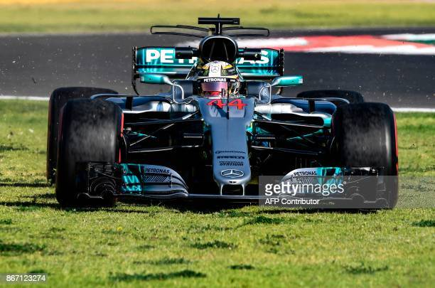 TOPSHOT Mercedes' AMG Petronas British driver Lewis Hamilton is pictured during the first free practice of the F1 Mexico Grand Prix at the Hermanos...