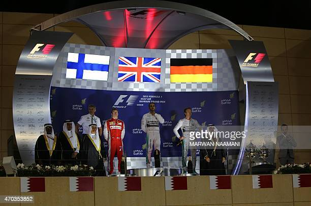 Mercedes AMG Petronas British driver Lewis Hamilton stands on the podium listening to his national anthem after winning the Formula One Bahrain Grand...