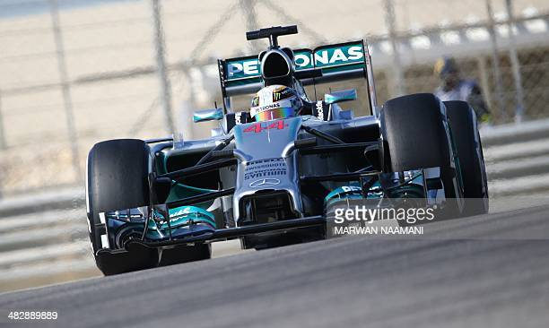 Mercedes AMG Petronas British driver Lewis Hamilton steers his car during the third practice session of the Formula One Bahrain Grand Prix at...