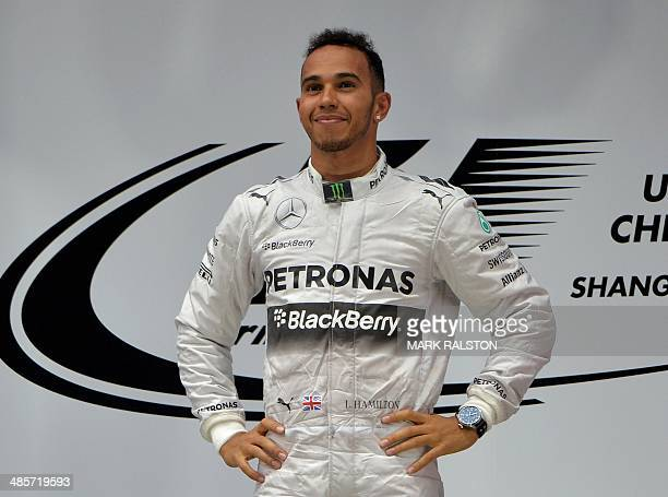 Mercedes AMG Petronas driver Lewis Hamilton of Britain celebrates on the podium after winning the Formula One Chinese Grand Prix in Shanghai on April...