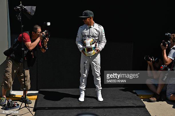 Mercedes AMG Petronas driver Lewis Hamilton of Britain poses during a photo shoot ahead of the Formula One Australian Grand Prix in Melbourne on...