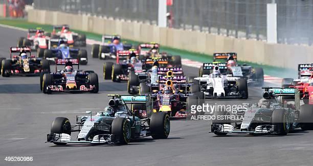 Mercedes AMG PETRONAS drivers British Lewis Hamilton and German Nico Rosberg are pictured during the start of the F1 Mexico Grand Prix at the...