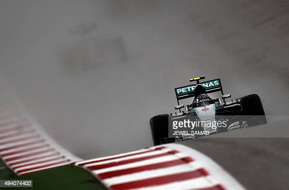 Mercedes AMG Petronas F1 German driver Nico Rosberg races on the wet track during the third practice session ahead of the US Formula One Grand Prix...