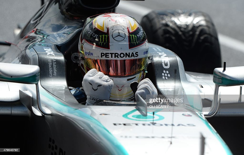 Mercedes AMG Petronas F1 Team's British driver <a gi-track='captionPersonalityLinkClicked' href=/galleries/search?phrase=Lewis+Hamilton+-+Racecar+Driver&family=editorial&specificpeople=586983 ng-click='$event.stopPropagation()'>Lewis Hamilton</a> celebrates after winning the British Formula One Grand Prix at the Silverstone circuit in Silverstone on July 5, 2015.