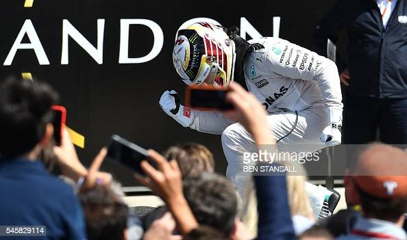 Mercedes AMG Petronas F1 Team's British driver Lewis Hamilton celebrates after winning the British Formula One Grand Prix at Silverstone motor racing...