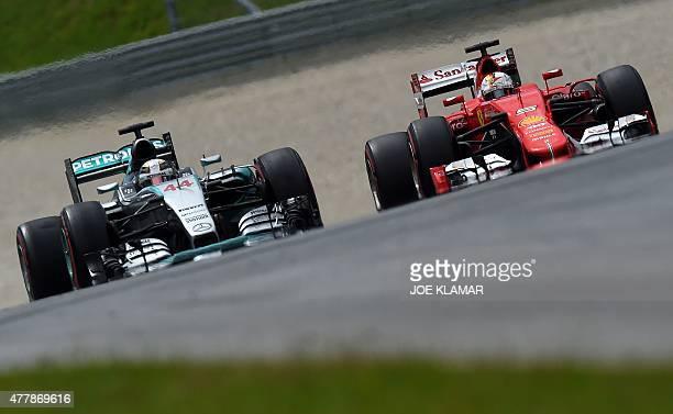 Mercedes AMG Petronas F1 Team's British driver Lewis Hamilton and Ferrari's German driver Sebastian Vettel race during the qualifying at the Red Bull...