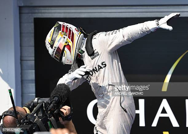 Mercedes AMG Petronas F1 Team's British driver Lewis Hamilton celebrates at the Hungaroring circuit in Budapest on July 24 2016 after the Hungarian...