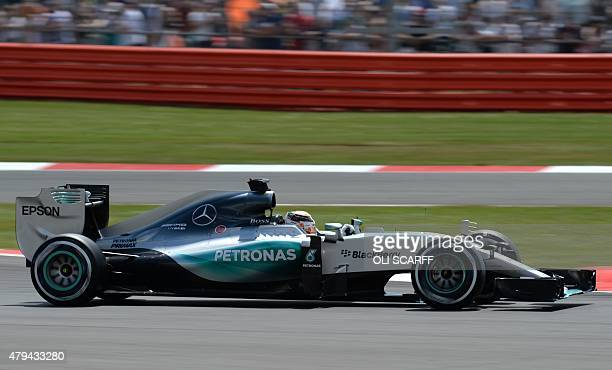 Mercedes AMG Petronas F1 Team's British driver Lewis Hamilton drives during the qualifying session at the Silverstone circuit in Silverstone on July...
