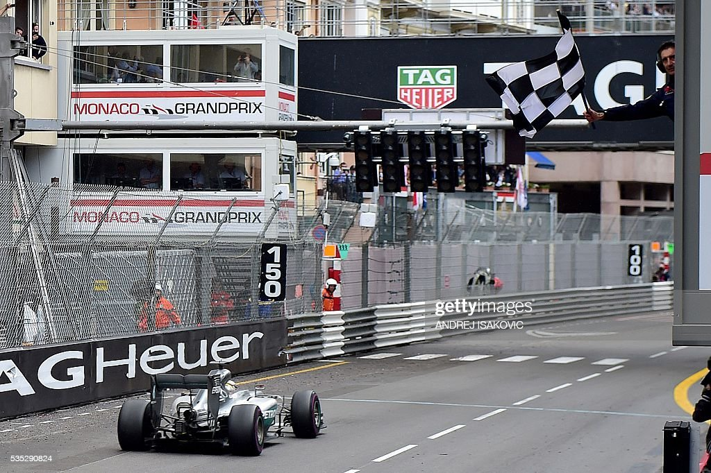Mercedes AMG Petronas F1 Team's British driver Lewis Hamilton drives as he crosses the finish line at the Monaco street circuit, on May 29, 2016 in Monaco, during the Monaco Formula 1 Grand Prix. / AFP / ANDREJ