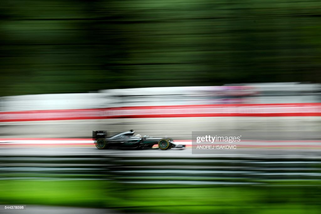 TOPSHOT Mercedes AMG Petronas F1 Team's British driver Lewis Hamilton drives during the Formula One Grand Prix of Austria at the Red Bull Ring in...