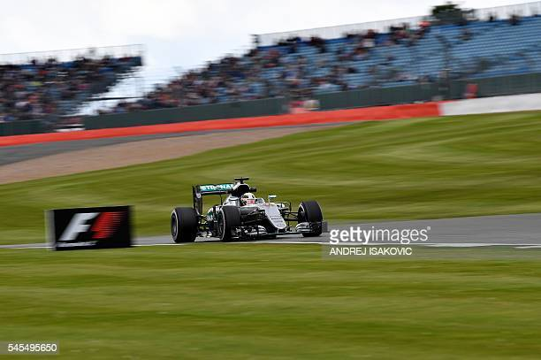 TOPSHOT Mercedes AMG Petronas F1 Team's British driver Lewis Hamilton drives during a practice session at Silverstone motor racing circuit in...