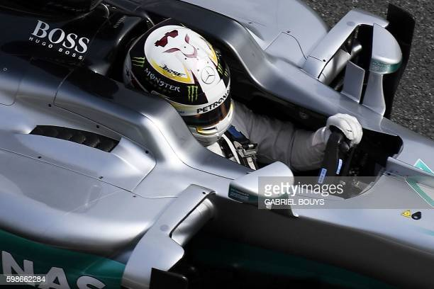 Mercedes AMG Petronas F1 Team's British driver Lewis Hamilton drives his car during the second practice session at the Autodromo Nazionale circuit in...