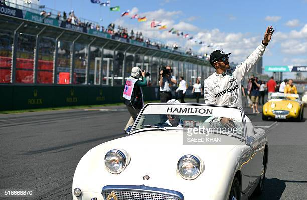 Mercedes AMG Petronas F1 Team's British driver Lewis Hamilton gestures to the crowd during the drivers parade before the start of the Formula One...