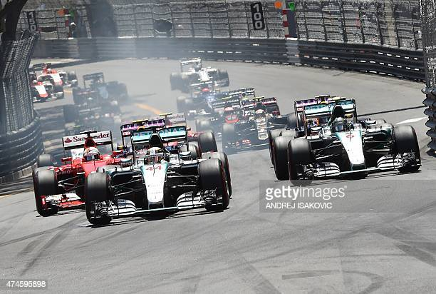 Mercedes AMG Petronas F1 Team's British driver Lewis Hamilton leads as drivers take the start of the race at the Monaco street circuit in MonteCarlo...