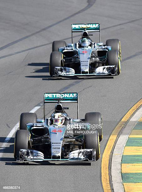 Mercedes AMG Petronas F1 Team's British driver Lewis Hamilton leads teammate German driver Nico Rosberg during the Formula One Australian Grand Prix...