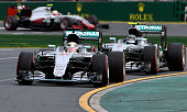 Mercedes AMG Petronas F1 Team's British driver Lewis Hamilton leads team mate Nico Rosberg of Germany during qualifying of the Formula One Australian...