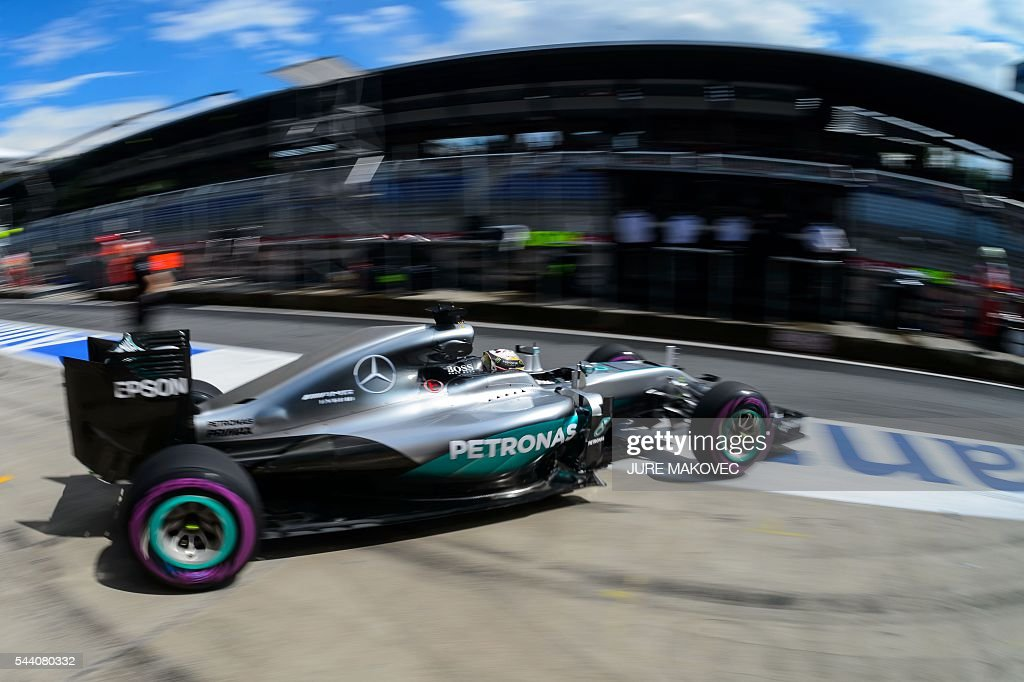 TOPSHOT - Mercedes AMG Petronas F1 Team's British driver Lewis Hamilton leaves the pit lane during the second practice session of the Formula One Grand Prix of Austria at the Red Bull Ring in Spielberg, Austria on July 1, 2016. / AFP / JURE