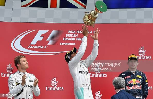Mercedes AMG Petronas F1 Team's British driver Lewis Hamilton celebrates on the podium after the British Formula One Grand Prix at Silverstone motor...